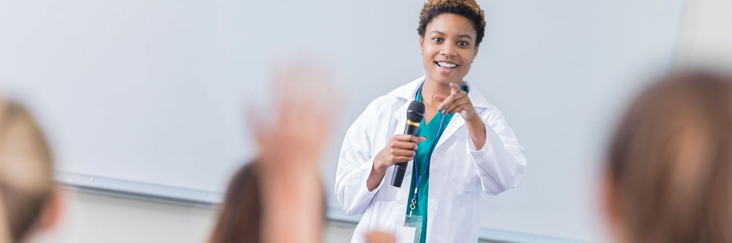 Female doctor teaching CME