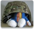 Petey wears a military helmet