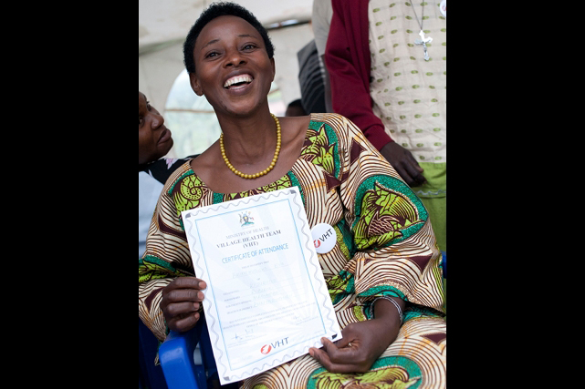 Smiling woman with VHT certificate