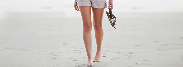 Banner: Girl walking on beach