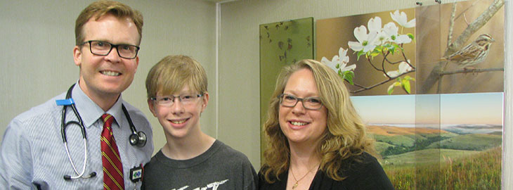 Image: 12 year old Jackson with mom and Dr. Anderson