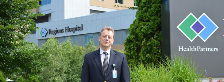 Image: Dr. Dudek standing in front of Regions Hospital