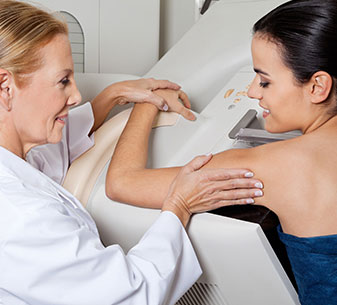 Breast health specialty page Doctor screening a woman