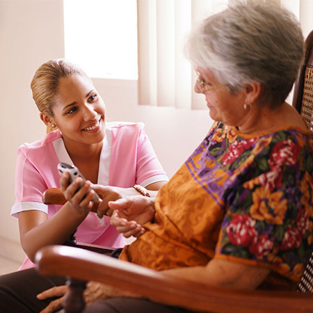 Image: Integrated Home Care nurse helping patient