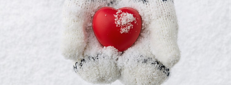 Image: Heart being held by snowy mittens