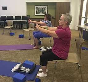 Image: Jenny Mateer does chair yoga at the HealthPartners Neuroscience Center